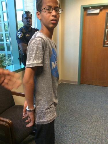 Ahmed Mohamed in cuffs for building a clock