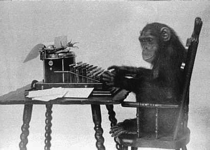 Chimpanzee at a typewriter. Via Wikimedia Commons.