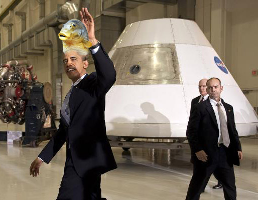 President Obama, wearing a kipper (why not), walks past props from the moon landing that was totally a hoax to perpetuate the myth of a round Earth. From a NASA image, with help from @darth.