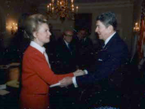 Phyllis Schlafly and Ronald Reagan in 1987, via Wikimedia Commons