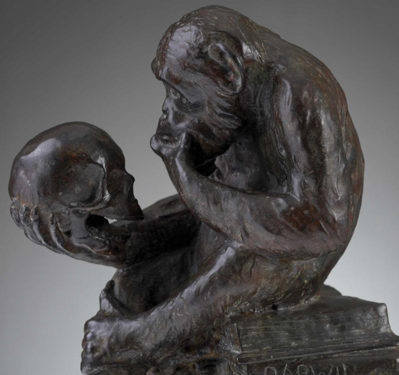 monkey with a human skull statue