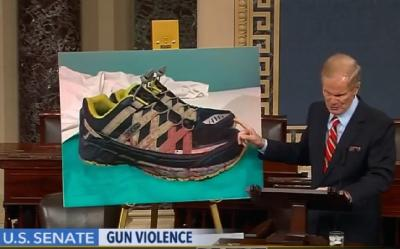 Senator Nelson shows the bloodsoaked shoes of a trauma surgeon who treated victims from the Pulse nightclub shooting