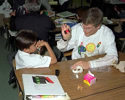 Teacher clarifying scientific principles