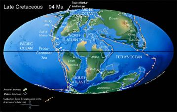 Cretaceous Continents: Christopher Scotese's reconstruction of the continental arrangement 94 million years ago.  The land bridge between North America and Asia is indicated at the upper left.  The connection between North and South America is also visible.  Africa is drifting away from other southern continents, but Australia, Antarctica and South America are linked.  Africa split off from this southern supercontinent beginning around 140 million years ago.