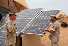 Marine officers inspect new solar panels: Marine Corps Reserve Col. Anthony Fernandez, commanding officer of Task Force African Lion in Morocco, inspects the solar panel of an Expeditionary Forward Operating Base module during the testing phase of this sustainable energy initiative. Image by Maj. Paul Greenberg.