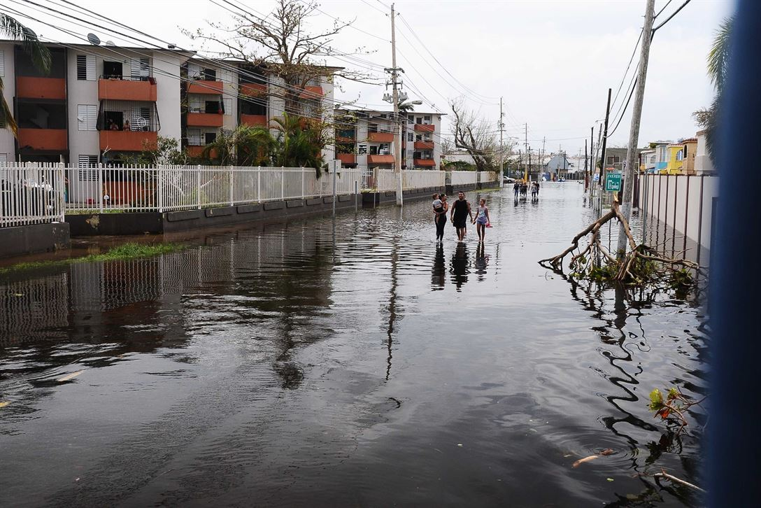 Puerto Rican residents walk in flooded streets in Condado, San Juan, Puerto Rico, Sept. 22, 2017, following Hurricane Maria. Puerto Rico National Guard photo by Sgt. Jose Ahiram Diaz-Ramos