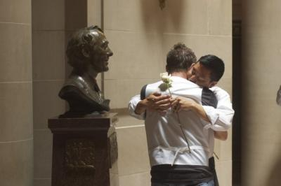 Gay couple weds at SF City Hall on June 29, 2013, before a statue of slain gay rights icon Harvey Milk