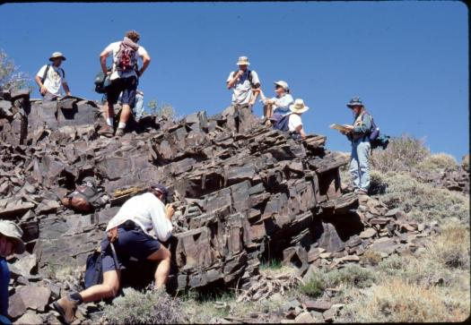geology students examining an outcrop