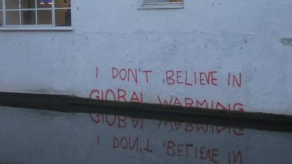 """I don't believe in global warming"" graffiti"