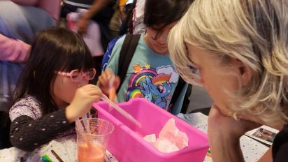 Young girl engaging in a science activity