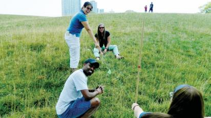 Teachers measuring sea level.