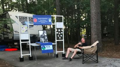 Setting up science outreach at a campground.