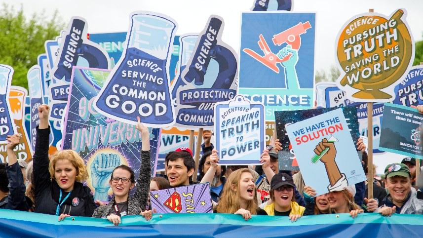 A group of people supporting science