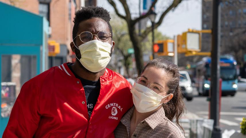 two people wearing glasses and face masks